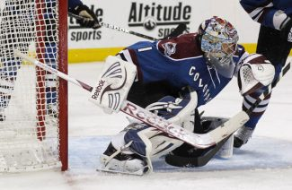 Colorado Avalanche goalie Semyon Varlamov, of Russia, makes a glove save of a shot against the Nashville Predators in the second period of an NHL hockey game in Denver on Saturday, March 30, 2013. (AP Photo/David Zalubowski)