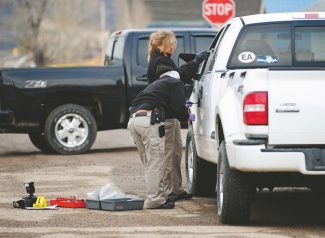 Investigators from the Colorado Bureau of Investigation examine a truck at the scene of a shooting in Hot Sulphur Springs on Monday morning.   Byron Hetzler/Sky-Hi News