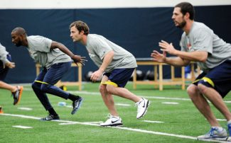 This photo provided by the Denver Broncos shows Wes Welker, second from right, stretches with teammates during NFL football off season training at Denver Broncos Dove Valley facility in Englewood, Colo., on Monday,  April 15, 2013. (AP Photo/Denver Broncos, Eric Bakke)