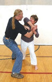 Daily file photoSean Cavins, of Sahn Tae Kwon Do, demonstrates self-defense techniques with Cathy Luc at the Breckenridge Recreation Center in a 2010 class.