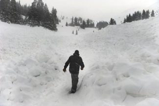LOVELAND PASS, CO. - APRIL 20:  A ten-foot thick slab of snow broke free and buried six backcountry thick snowboarders in an avalanche in Sheep Creek Bowl below Loveland Pass Saturday, April 20, 2013.  One survived but the others five died at the scene. Photo By Karl Gehring/The Denver Post