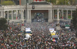FILE - This April 20, 2012 file photo shows a cloud of smoke covering the crowd at the Denver 420 rally in Civic Center Park. Denver Police are bracing for this year's event on Saturday, April 20, 2013 which is expected to draw a record crowd of 80,000 people. (AP Photo/The Denver Post, Daniel Petty, File)