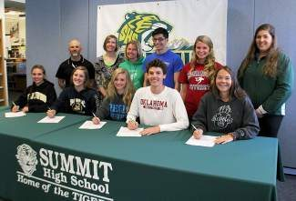 Seven of Summit High's graduating seniors recently commited to continuing to pursue their sports in college either through verbal commitment or signed letters of intent.  Front: (Left to right) Taylor Bohlender, Lilly Weldon, Kathrine Pappas, Liam Meirow, Kates Raymond. (Back row) Coaches: Karl Barth, Heather Quarantillo, Kristy McClain, Athletes: Robert Koegel, Tucker Hackett, and coach Kristin Sposato.