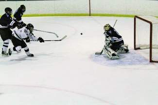Jack Nevicosi scores on Valor Christian's goalie. Summit lost in overtime 4-3.
