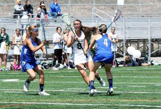 Former Summit girl's lacrosse team captain Kates Raymond makes a move to get past two Fruita Monument defenders in the final game of the 2015 season. This year's team started the season against Fruita Monument on March 11 and lost, 4-18, to begin the season 0-1.