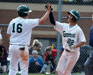 Summit High School's Ricky Seltzer (22) is congratulated by teammate Ben Hull (16) after hitting a two-run home run against Glenwood Springs last season. Head coach Tom Looby is looking for another strong season despite losing seven seniors, including six starters like Seltzer.