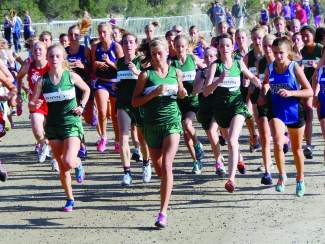 Summit's McKenna Ramsay (middle) leads the start at a cross-country meet in 2014. Now a senior, Ramsay leads a large track and field team with a history of individual and team success at the league and state tournaments.