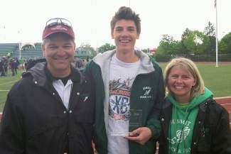 Summit senior Liam Meirow(center), poses with Tiger track coaches Kristy McClain and Fred Koetteritz after Meirow received the Boys MVP award for the Western Slope League Championship Saturday.