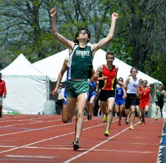 Summit High School's Liam Meirow celebrates after winning the 1,600 meters on Saturday during the final day of the Class 4A State Championships at Jefferson County Stadium in Lakewood. Meirow won the event in 4 minutes, 18.72 seconds.