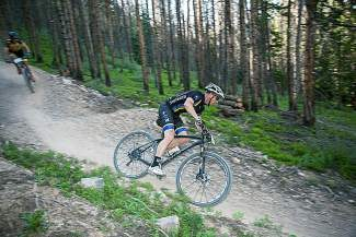 Jeff Cospolich charges down the Slalom Singletrack trail — a newer edition to the Golden Horseshoe trail network— during the Summit Mountain Challenge's Gold Run Rush, Wednesday, June 25.