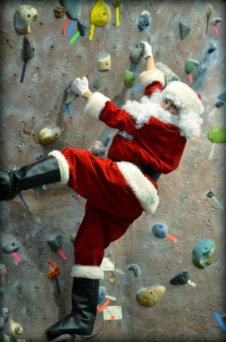 Training for the job: Santa shows his chimney climbing skills on the wide-open wall at the Breckenridge Recreation Center. He climbs without ropes only on Christmas.