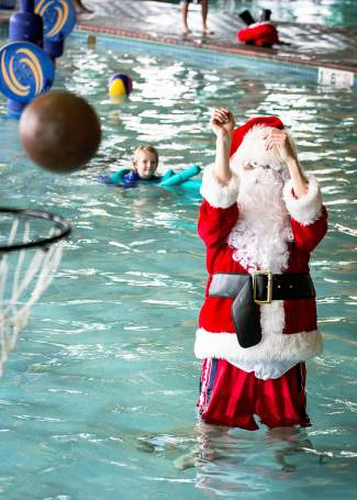 Booyakasha: Santa sinks one from way back in the water during open swim at the Breckenridge Recreation Center. You should see what he can do from a flying sleigh.