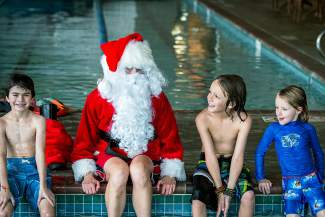 Never too late to make the good list: Santa listens to wishes from Breckenridge Mountain campers (left to right) Luka Teodoru, Sage Fischer and Haylen Fischer at the Breckenridge Recreation Center pool.