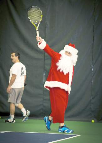 Quality control: Santa takes a few practice swings to test little Johnny's gift before Christmas at the Breckenridge Recreation Center.