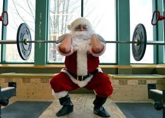 Perfect form: Santa proves the bowl-full-of-jelly thing wrong with front squats in the weight room at the Breckenridge Recreation Center. He also does back squats.