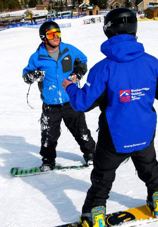 An instructor (right) gives pointers to a member of the Team Semper Fi group at Keystone last week. The Keystone Adaptive Center worked with 34 veterans for three days to learn adaptive skiing, snowboarding and mono-skiing.