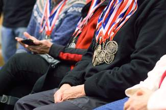 An athlete wears more than a few medals during the award ceremony for competitors in the 35th annual Summit County 50+ Winter Games in 2015 at the Summit County Community and Senior Center. The Games return to town this week with events in Keystone on Monday and the Frisco Nordic Center on Tuesday, followed by awards at the senior center Tuesday night.