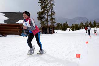 Sandy Davis, 69, of Silverthorne, races to the finish of a snowshoe event during the 35th annual Summit County 50+ Winter Games in 2015 at the Frisco Nordic Center. The Games return to town this week with events in Keystone on Monday and the Frisco Nordic Center on Tuesday.