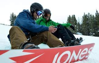 Dwight Eppinger, left, director of marketing at Copper Mountain Resort, explains to Gregg Blanchard, operator of the blog Ski Fillers, how to use the mobile application, Sherpa, during an on-snow tutorial Wednesday at Copper Mountain. Sherpa, now available at no cost on the iTunes and Android market places, is a GPS-enabled app that provides users with a guided audio tour of the mountain.