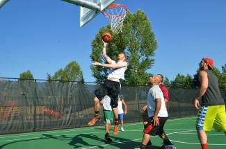 A player drives for a layup during the annual three-on-three basketball tournament at the Silverthorne Recreation Center. The tourney returns to the rec center on July 30, with registration still available online through www.3on3atthesummit.com.