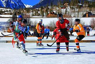Women's teams battle for the puck at the Pabst Colorado Pond Hockey Tournament in 2015. The tourney returns to North Pond this weekend with 150 teams from 45 states and several countries.