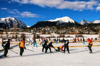 The scene on the first day of hockey action for the Pabst Colorado Pond Hockey Tournament in Silverthorne, held Friday through Sunday at North Pond Park. The weekend features 150 teams from across the globe and funky contests, including best costume and best hockey hair.