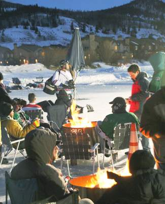 Teams stay warm with beer and a bonfire at the2015  Pabst Colorado Pond Hockey Tournament in Silverthorne. The tourney returns to North Pond this weekend with 150 teams from 45 states and several countries.