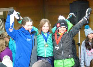 Loveland Ski Club U-10 racers Loagn Hale (middle) and Nives Martinetti (left) after going one-two respectively in the U-10 girls slalom at Eldora on Feb. 6 and Feb. 7. The club's U-10 girl's crew is undefeated this season, with at least one skier reaching the podium at every pre-championship race.