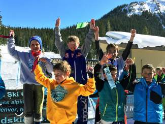 Loveland Ski Club U-12 athletes Wyatt Huston (middle) and Miko Lewis (second from right) after going 1-2 at the Loveland YSL Championships slalom on March 20.