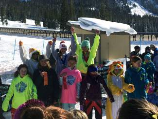 Loveland Ski Club racers Erin Pointet (second from left on podium) and Chloe Baughn (center on podium) celebrate after taking second and first, respectively, at the Loveland YSL Championships U-12 giant slalom on March 19.