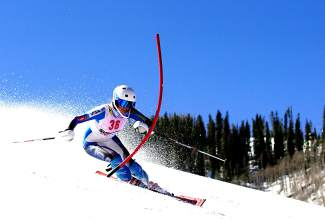 Team Summit Colorado alpine skier Jordan Watts rounds a gate during a race last season.