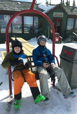 Roan and Dade Bissell take a break between runs at Telluride on March 3, 2016. At the start of the season, the Bissell family set their sights on skiing at least one full day at all 29 Colorado ski areas and completed the journey at Arapahoe Basin on April 24 — dad JB Bissell's birthday.