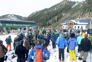 The line waiting for Black Mountain Express at Arapahoe Basin on opening day. The mountain saw about 2,000 skiers and riders during the day, with lift line wait times around 10-15 minutes.