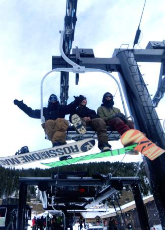 A group of snowboarders celebrates shortly after loading their first chair of the 2015-16 ski season at Loveland Ski Area on opening day, Oct. 29. It was one of the mountain's latest opening days in nearly a decade.