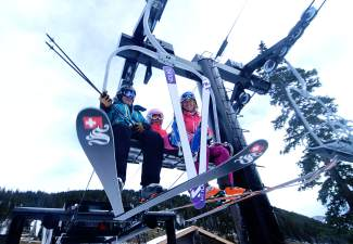 A group of skiers takes off from the base of Lift 1 at Loveland Ski Area early on the morning of opening day, Oct. 29, shot by @sumcosports