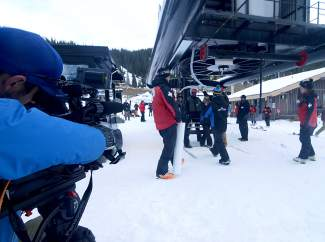 A cameraman with a Denver TV station lines up his shot before the first chair of the Colorado ski season at Loveland Ski Area on Oct. 29. About 100 people lined up to get first tracks on opening day.