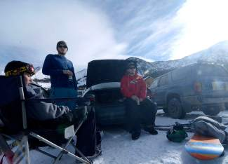 Golden locals (from left) Alex Janzen, Danny Lanciotti and Keegan O'Day take a break between runs on opening day at Arapahoe Basin. By 10 a.m., the early-risers had already cracked beers for a bit of tailgating at The Beach.