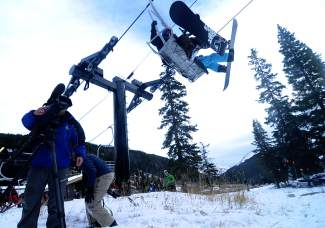 A cameraman with Denver TV station catches skiers riding up Lift 1 at Loveland Ski Area on opening day. Loveland drew hundreds of skiers and snowboarders from across the state and country for opening day, including first-chair legend Nate Dogggg, who has been on Colorado's first chair for the past 20 years.