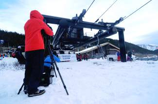 Cameraman get ready for the money shot just moments before the first chair of the 2015-16 ski season at Loveland Ski Area on Oct. 29. Thousands of skiers and snowboarders arrived in Loveland and Arapahoe Basin for one of the latest opening days in the past decade.