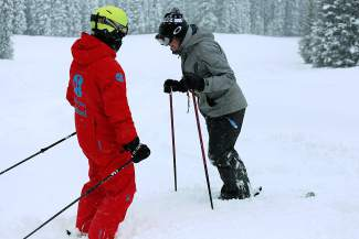A ski instructor works with a student during a powder lesson at Copper Mountain. Local ski school instructors and ski club coaches recommend finding some type of professional instruction to move past plateaus, even if you're an intermediate or expert skier.