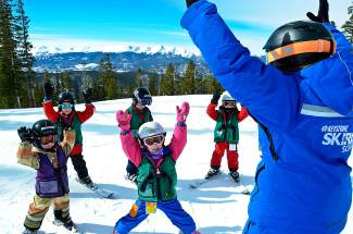 A ski instructor guides young students through a few flat-land exercises before heading onto the snow. Local resorts offer lessons for three types of students: beginners, intermediate/advanced skiers and expert skiers.