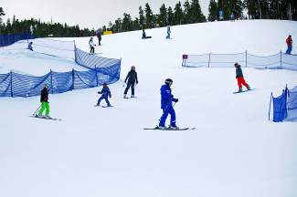 An instructor leads a family ski lesson through the baffles on a run at Keystone. Family lessons are one of several options at the resort for beginners skiers who want to improve.