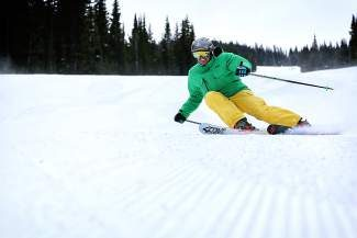 A skier carves a sharp turn on a groomer at Copper Mountain Resort earlier this season. Longtime ski instructor Johnathan Lawson says a true carved turn starts with a gradual movement early in the turn. Skiers should engage their edges early in the turn, but most intermediate skiers don't get on the edges of their skis until the end of the turn.