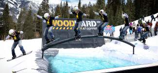 A snowboarder slides the rainbow rail over the pool at the 2015 Red Bull SlopeSoakers competition on closing weekend at Copper. The event returns this Saturday with division for skiers and snowboarders of all ages.