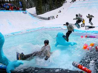 A snowboarder goes for the inflatable whale bonk at the 2015 SlopeSoakers rail jam, held on closing weekend at Copper Mountain. The event returns this season with several new features and a single, massive pool.