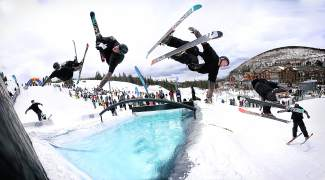 A skier hucks a cork 360 over the pool at the 2015 Red Bull SlopeSoakers rail jam, held at Copper Mountain on closing weekend. The event returns this year with a single pool venue and several new features, like a 70-foot log beneath a waterfall.