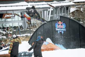 Fairplay's Clayton Conway throws a Christ air over the pool at the 2016 Red Bull SlopeSoakers rail jam in Copper on April 17.
