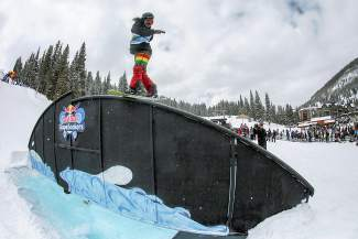 A snowboarder goes frontside boardslide over the orca rainbow at the 2016 Red Bull SlopeSoakers rail jam in Copper on April 17.