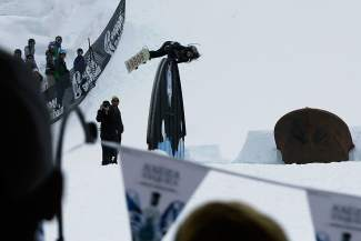 A snowboarder throws a taco slide on the hump of the orca rainbow at the 2016 Red Bull SlopeSoakers rail jam in Copper on April 17.