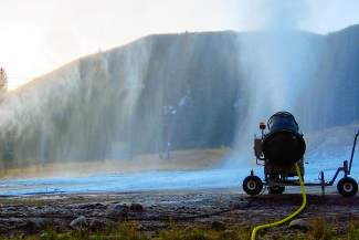 Snow guns fire at Keystone Resort early Friday, Oct. 16, 2015, ahead of the ski area's planned Nov. 6 opening day.